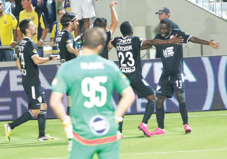 Hapoel Ra'anana players celebrate with striker Evans Kangwa (right)