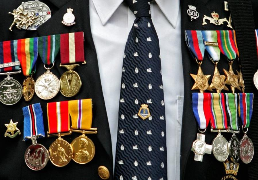 Medals are seen on the jacket of British World War II veteran during an event to mark VJ Day