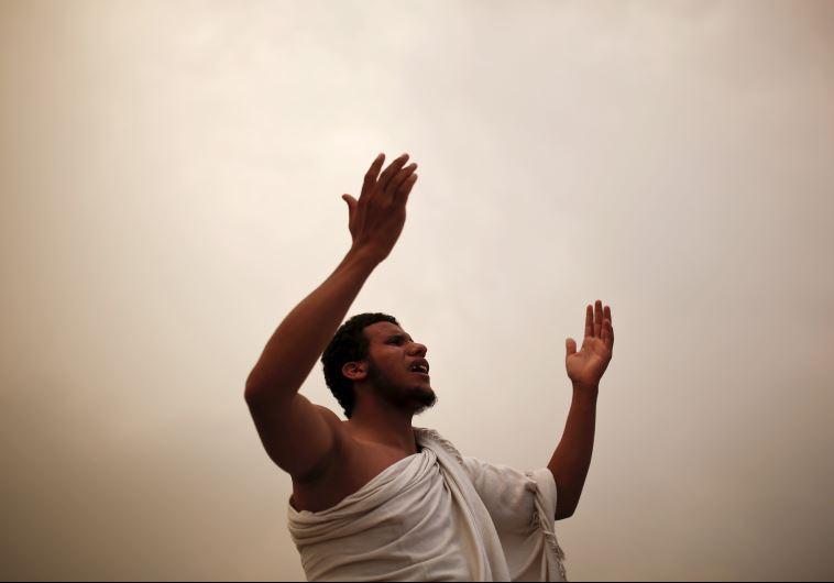 Muslim pilgrims pray on Mount Mercy on the plains of Arafat during the annual haj pilgrimage