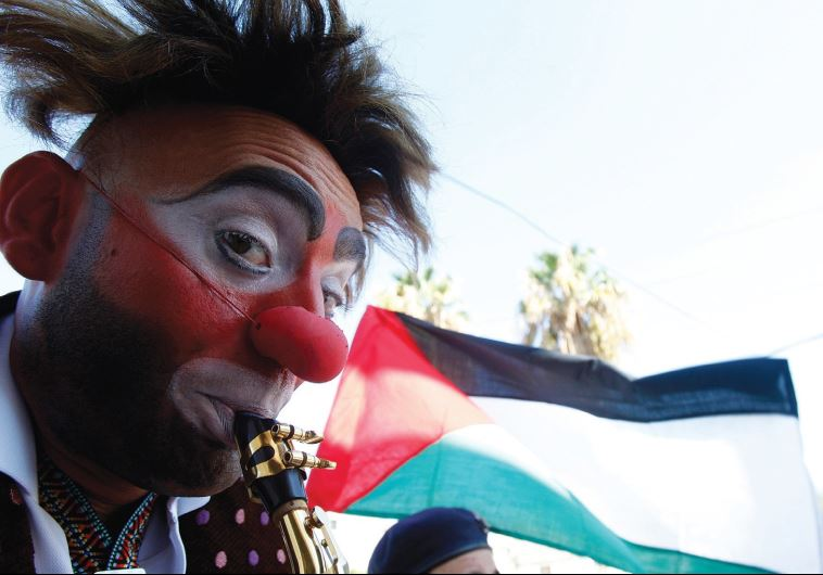 A SPANISH CLOWN performs, fully dressed, during a tour at Ein al-Hilweh Palestinian refugee camp nea