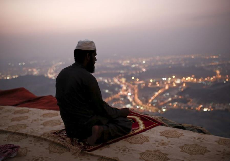 A Muslim pilgrim prays atop Mount Thor in the holy city of Mecca ahead of the annual hajj pilgrimage