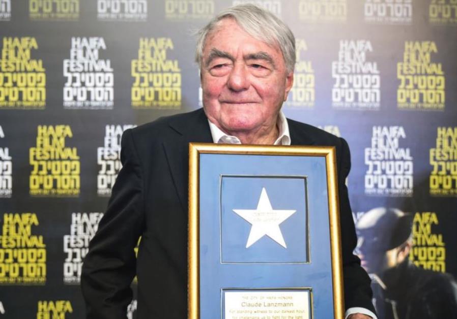 DOCUMENTARY FIMLMAKER Claude Lanzmann poses with his Lifetime Achievement Award at the 31st Haifa In