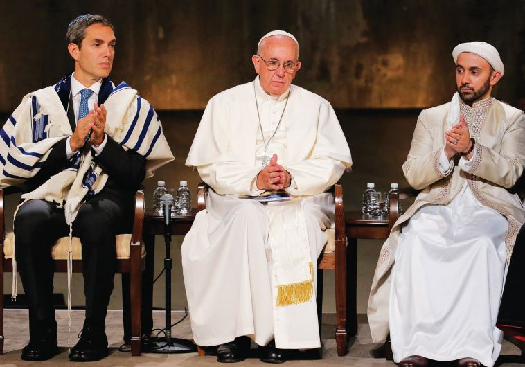 POPE FRANCIS sits with Rabbi Elliot J. Cosgrove and Iman Khalid Latif, Executive Director of the Isl