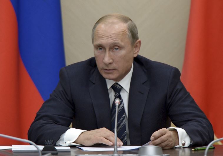 Russian President Vladimir Putin chairs a meeting with members of the government at the Novo-Ogaryov