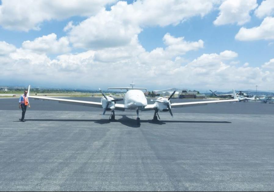 A DOMINATOR XP Medium Altitude Long Endurance drone is poised on the runway in Mexico