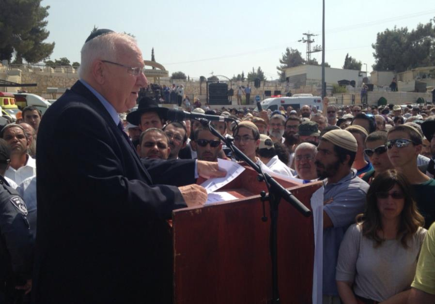 President Reuven Rivlin speaks at the funeral of Eitam and Na'ama Henkin