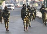 IDF soldiers take up positions during clashes with Palestinian youths in Nablus
