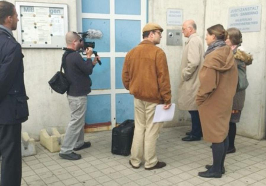 STEPHAN TEMPL (center) prepares to enter Simmering jail in Vienna