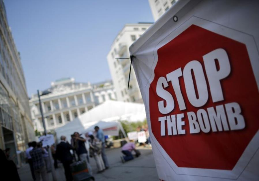 "A sign which reads ""Stop the Bomb"""