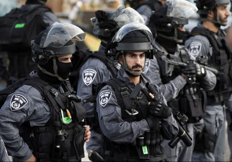 Israeli security forces stand guard in front of the Damascus Gate near the Old City of Jerusalem