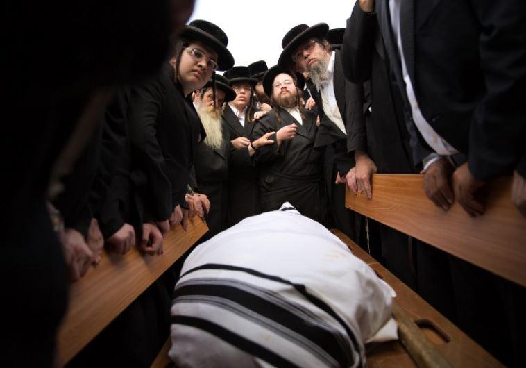 Ultra-Orthodox Jews mourn over the body of 60-year-old Rabbi Yeshayahu Krishevsky