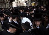 Thousands of Ultra-Othodox Jews walk behind the body of Rabbi Yishayahu Krishevsky during his funera