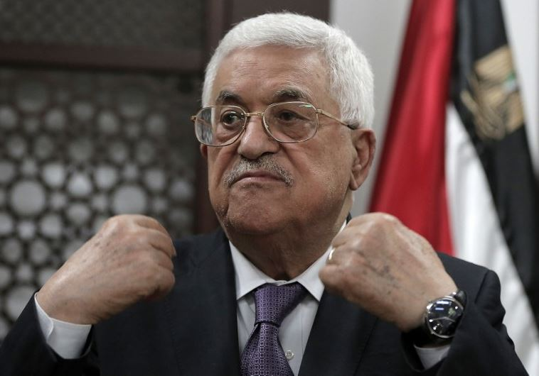 Palestinian Authority President Mahmoud Abbas speaks with journalists at his office in the West Bank