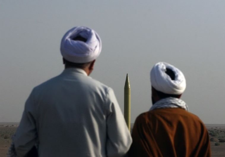 Iranian clerics look at a ballistic missile Shahab 1