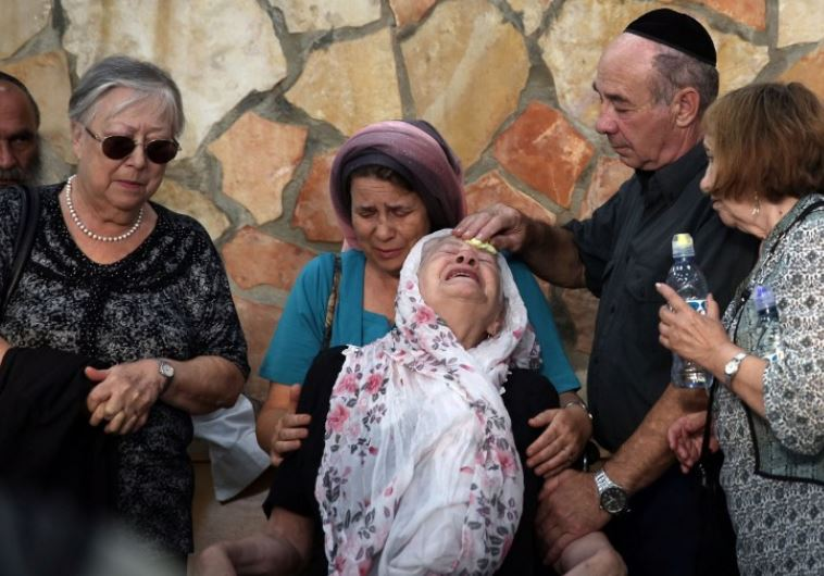 The mother of 51-year-old Israeli Alon Guverg mourns during his funeral