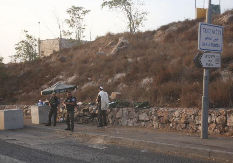 Border Police man a roadblock erected at the entrance to the e. Jerusalem village of Jebl Mukaber