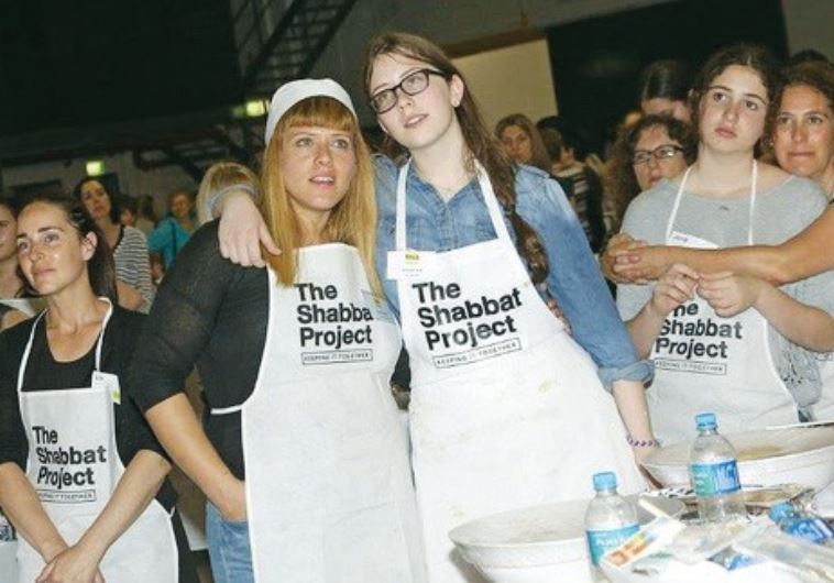 AROUND 2,400 women gather in an inner-Sydney warehouse for a mass bake-off to prepare halla for the