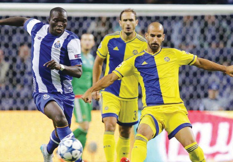 Porto forward Vincent Aboubakar (left) scored the opening goal last night against Gal Alberman (righ