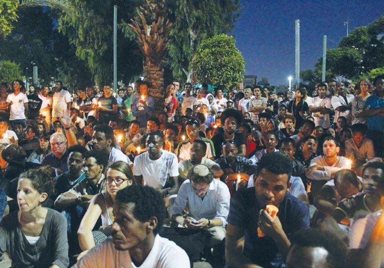 MOURNERS HOLD a candle-light vigil for Eritrean Haptom Zarhum in Tel Aviv's Levinsky Park last night