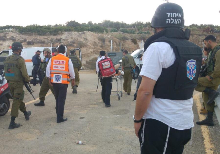 Emergency medical teams at terror scene in Gush Etzion
