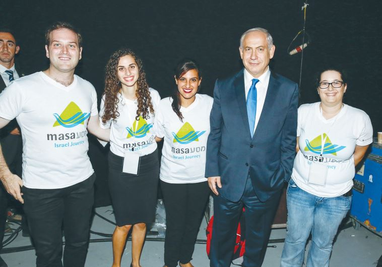 PRIME MINISTER Benjamin Netanyahu poses with participants in the MyMasa Event in Jerusalem last nigh