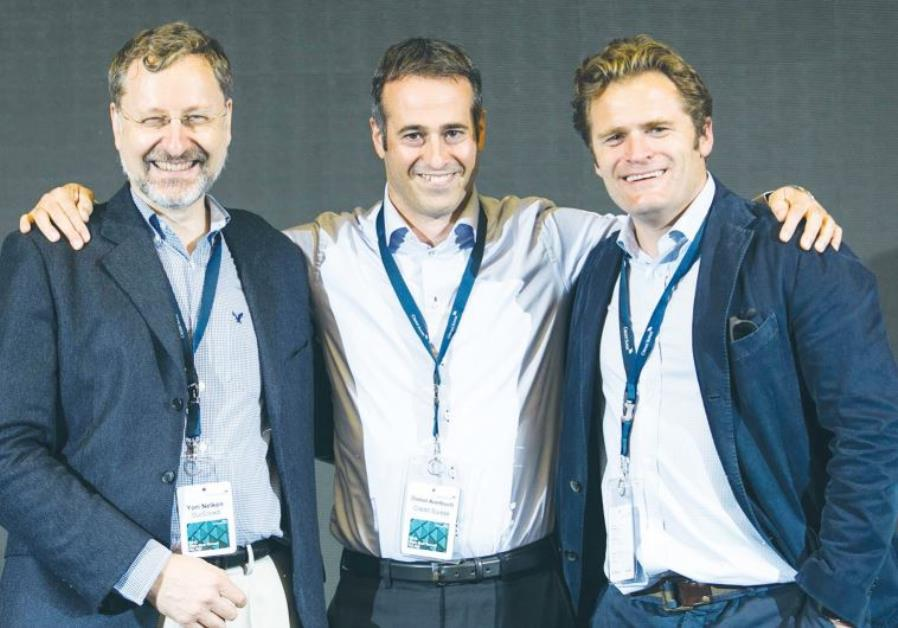YORI NELKEN of OurCrowd, Doron Averbuch of Credit Suisse and a representative of CodeMonkey pose for