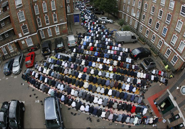 Muslims attend Friday prayers during the second day of Ramadan in east London