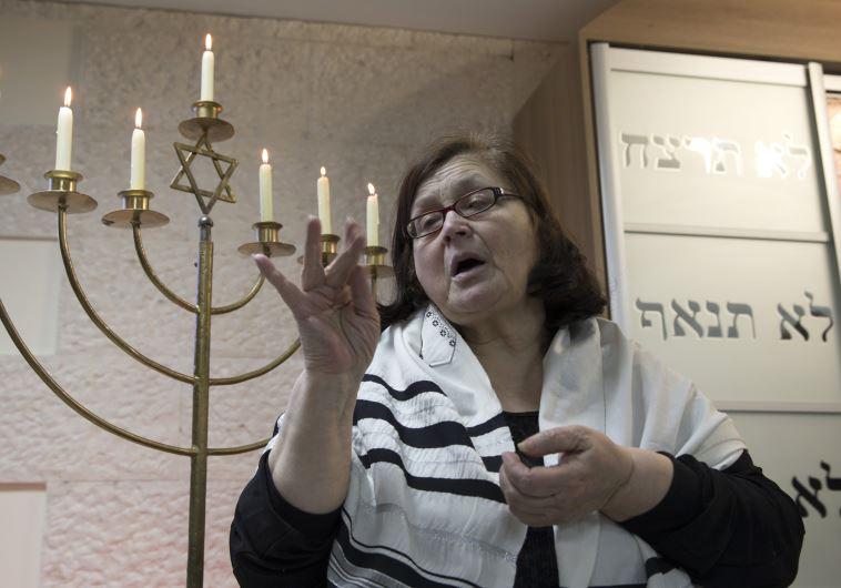 A sign language interpreter translates a prayer during a ceremony