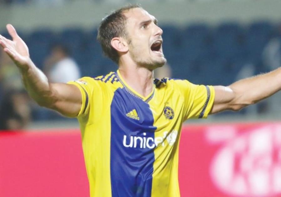 Maccabi Tel Aviv defender Carlos Garcia celebrates after scoring his team's winner