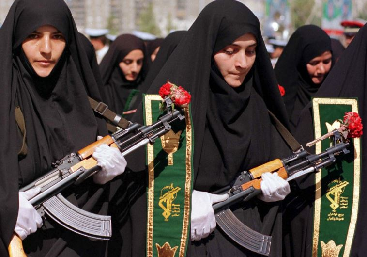 Iranian women mark the 20th anniversary of the start of the Iran-Iraq war during a military parade