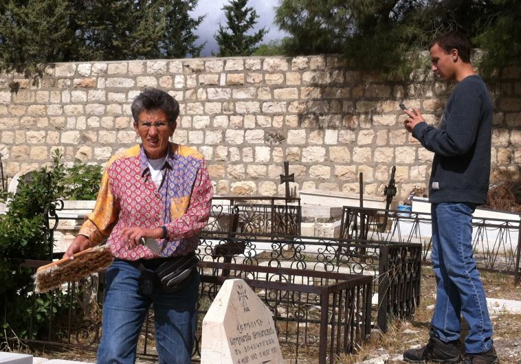 Interfaith delegation cleans Mount Zion graves