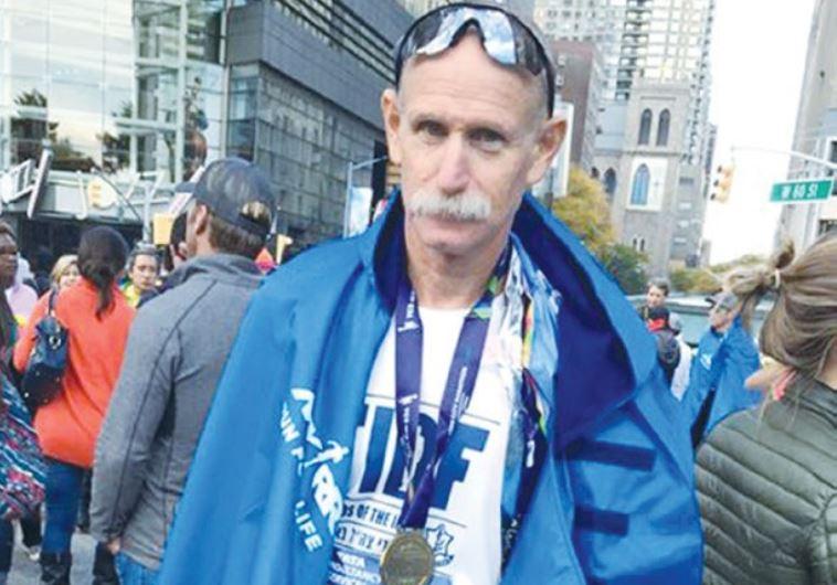DISABLED IDF veteran Adi Deutsch shows off his medal at Manhattan's Columbus Circle