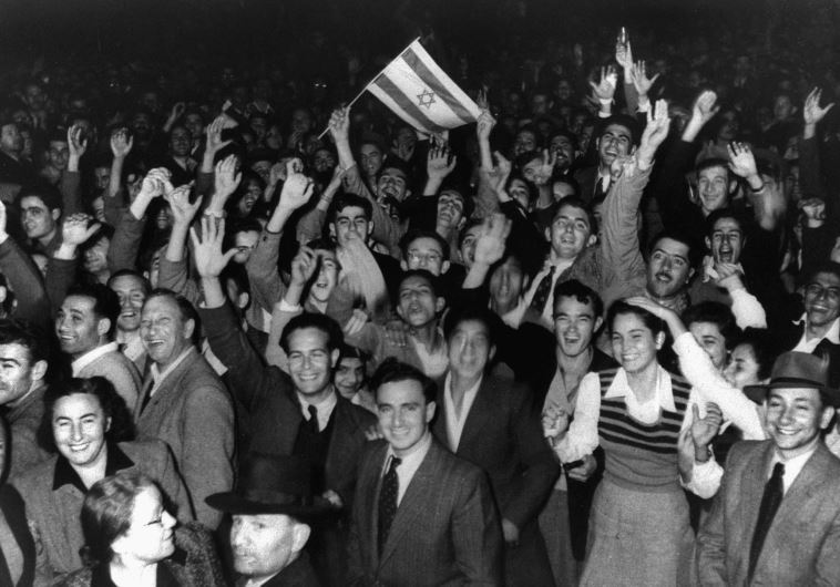 Jews celebrate in the streets of Tel Aviv moments after the UN voted to partition Palestine