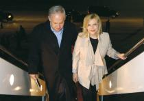 PRIME MINISTER Benjamin Netanyahu and his wife, Sara, board a plane
