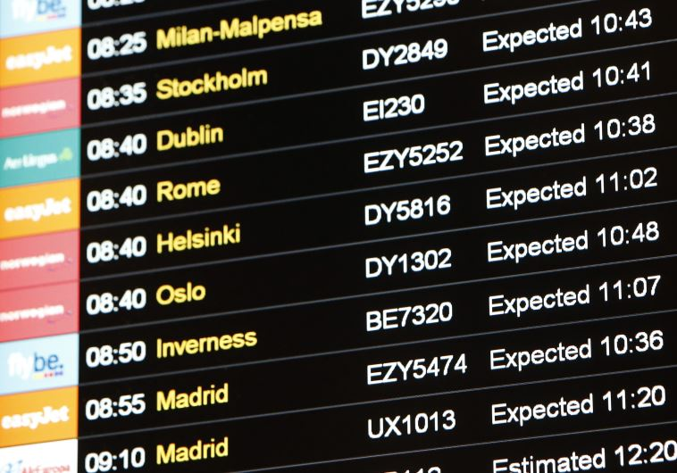 A flight information board is seen at Gatwick Airport in southern England December 7, 2013.