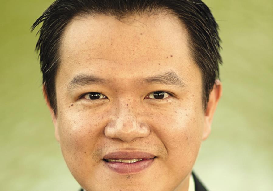 CONDUCTOR AND composer Yi-An Xu.