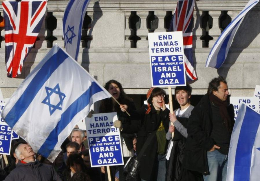 Pro-Israel demonstrators wave banners during a rally in London