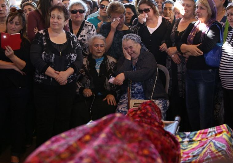 Relatives and friends mourn during the funeral of Reuven Aviram, 51