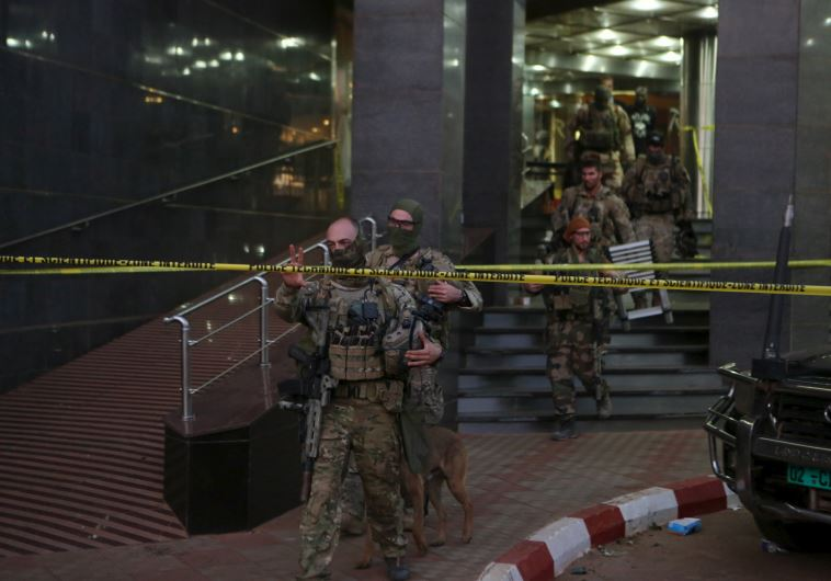 French soldiers leave the Radisson hotel in Bamako, Mali, Nov 20