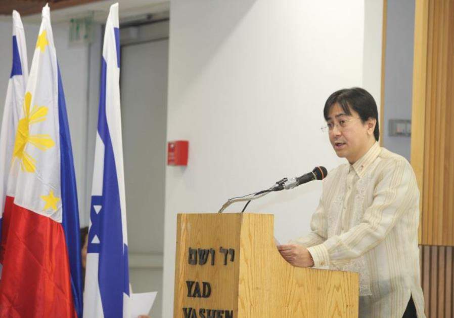 PHILIPPINE AMBASSADOR to Israel Nathaniel Imperial delivers an address at a Yad Vashem
