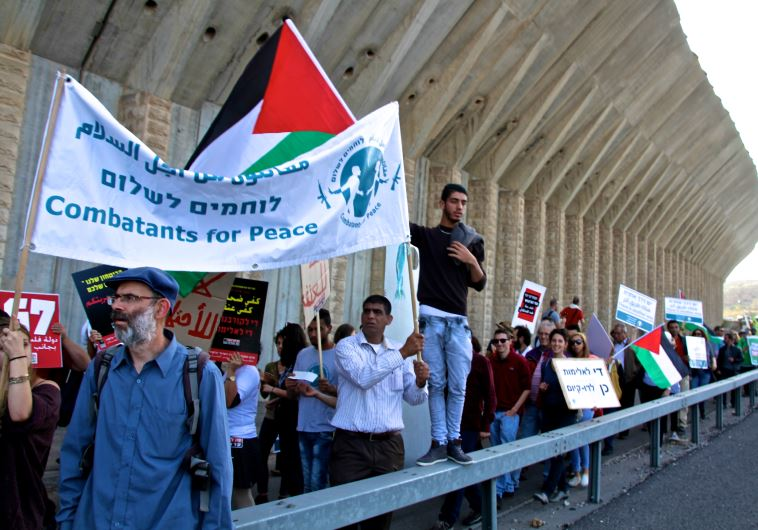 Israelis and Palestinian rally for peace along Route 60 in the West Bank on Friday