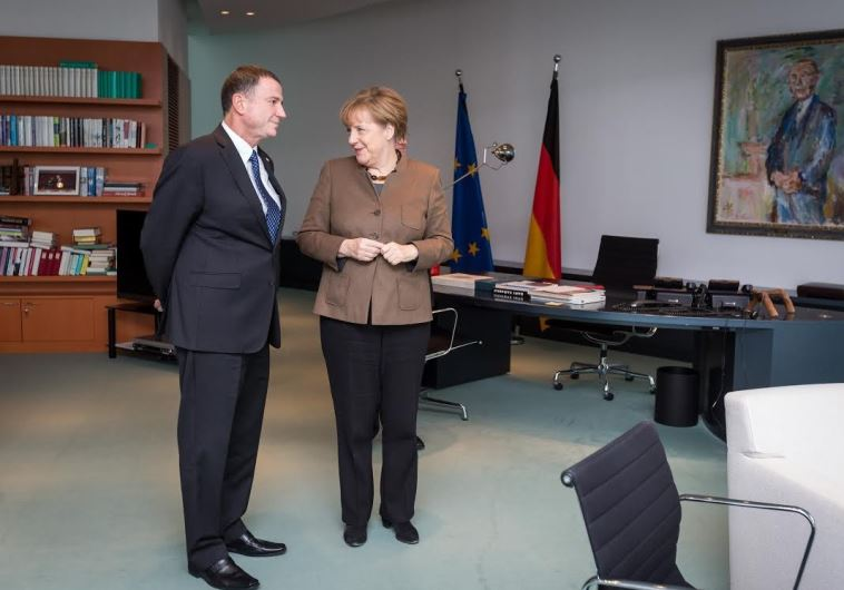 German Chancellor Angela Merkel (R) and Knesset Speaker Yuli Edelstein meet in her office in Berlin