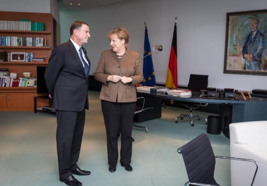 German Chancellor Angela Merkel (R) and Knesset Speaker Yuli Edelstein meet in her office in Berlin