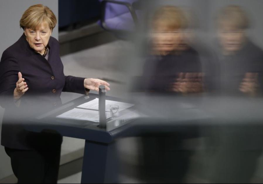 German Chancellor Angela Merkel addresses a session of the German lower house of parliament