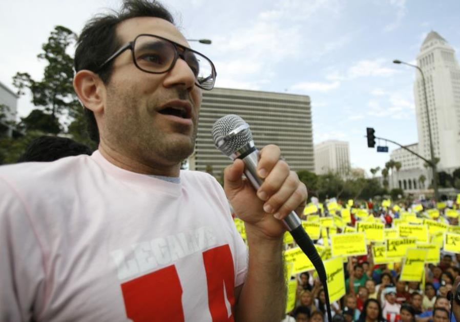 American Apparel owner Dov Charney speaks during a May Day rally protest march for immigrant rights,