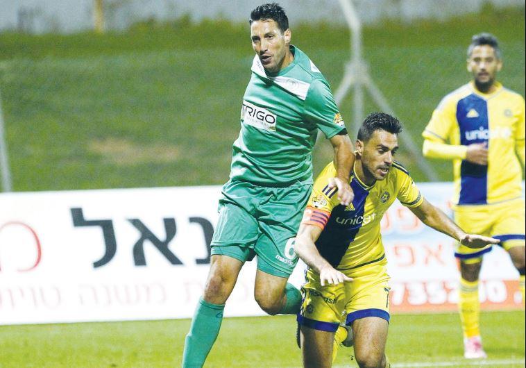 Maccabi Tel Aviv and captain Eran Zahavi (right) stumbled against Hapoel Kfar Saba and Amir Nusbaum