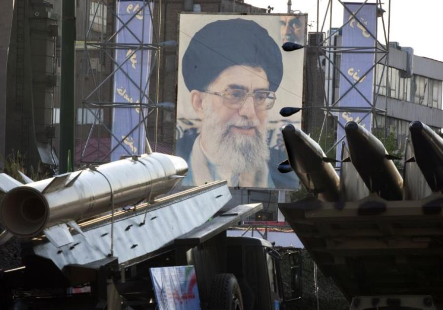 Iranian-made Fateh 110 (Conqueror) (L) and Persian Gulf (R) missiles