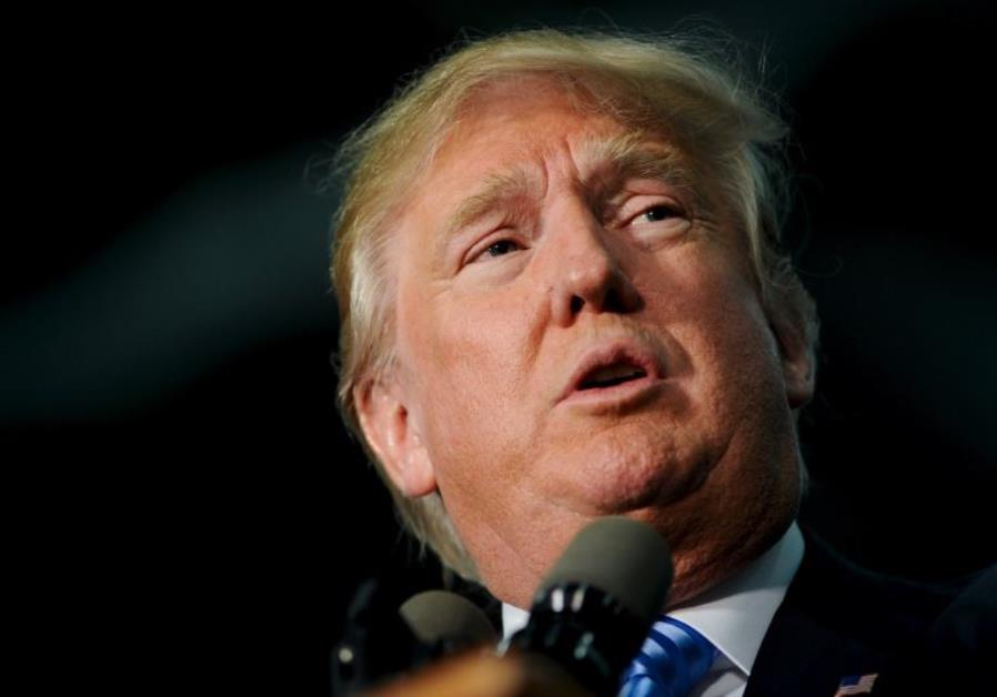 US Republican presidential candidate Donald Trump speaks at a campaign stop in Spencer, Iowa