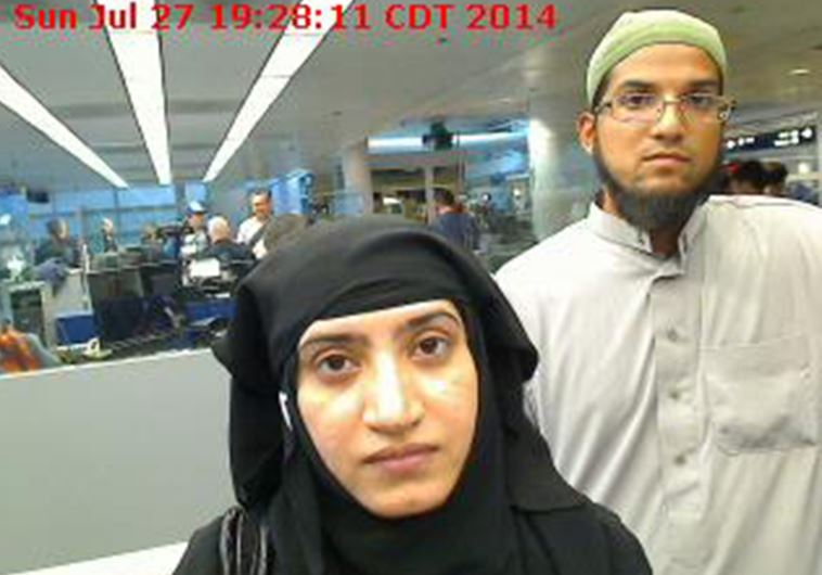 Tashfeen Malik, (L), and Syed Farook are pictured passing through Chicago's O'Hare Airport