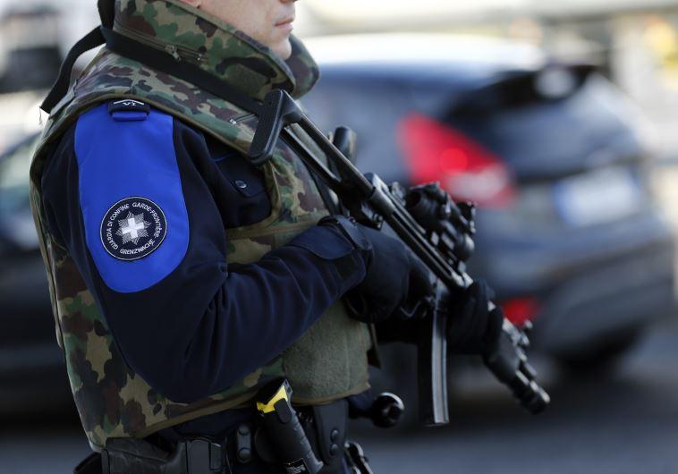 Swiss customs officer stands guard